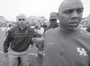 Kentucky head coach Joker Phillips, right, left the field after shaking hands with Vanderbilt head coach James Franklin, left, after Vanderbilt beat Kentucky 38-8 n Nashville. (AP Photo)