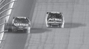 Tony Stewart, left, led Carl Edwards, right, during the NASCAR Sprint Cup Series auto race at Homestead-Miami Speedway on Sunday. Stewart won the race and the season title, a turn of events that Edwards accepted with a large amount of class. (AP Photo)