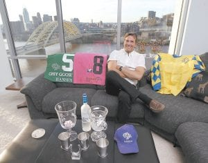 Dr. Kendall Hansen, horse owner and breeder, poses in his Newport condo. (AP Photo/The Cincinnati Enquirer)