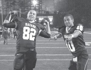 — Hilton Dixon, left, son of Johnette and Victor Gainer of Whitesburg, is a freshman member of the Hazard High School football team. The Bulldogs will be playing for the Class A state championship this Friday (Dec. 2) in a game against Mayfield at Western Kentucky University, where kickoff will be 11 a.m. (12 p.m. EST). Dixon is pictured celebrating with fellow freshman Jalen Olinger, son of Tiffany Olinger and William Warren of Hazard, after Hazard easily defeated Pikeville, 57-35, in the semifinals.