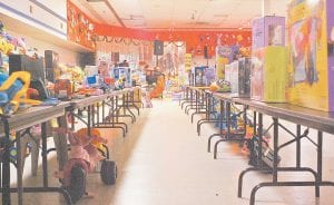 Toys and other gifts line tables at old Food World grocery store building at Ermine.