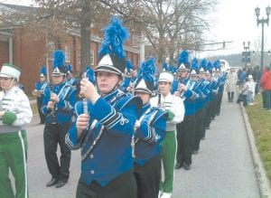 Members of the Jenkins and Letcher County Central High School bands joined Tuesday to represent Letcher County during a parade from the streets of Frankfort to the Kentucky State Capitol. The parade was held as part of the inauguration of Gov. Steve Beshear, who becomes only the third governor in Kentucky's history to serve consecutive terms. Beshear, a Democrat, is 67. See related story inside. (Photo by Dan Brennan)