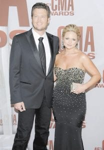 """Married country singers Blake Shelton, left and Miranda Lambert arrived at the 45th Annual CMA Awards in Nashville last month. Lambert is paying tribute to Shelton's late brother with her new single, """"Over You."""" (AP Photo)"""