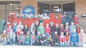 The Whitesburg Middle School UNITE Club sang Christmas carols in downtown Whitesburg on Dec. 9.