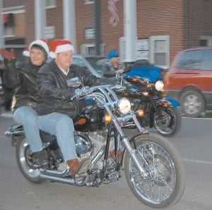 Letcher County Judge/Executive Jim Ward and his wife, Joan, rode through the Whitesburg Christmas Parade on a motorcycle.