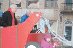 Whitesburg Mayor James W. Craft (pictured above left) and Letcher County Court Clerk Winston Meade rode in a large sleigh in the Christmas parade in downtown Whitesburg on Dec. 9. Meade served as grand marshal of the parade. Also riding on the sleigh as it made its way up Main Street were Olivia Hammock, 10, and Molly Hall, 2.
