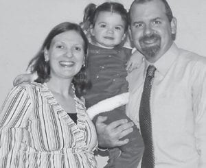 Matt and Rockie Hatton Hill of Lexington, are pictured with their daughter, Elise.