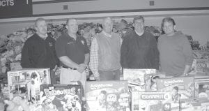 Marlow Tackett, pictured far right, posed with (from left) Deputy Letcher Judge/Executive Eddie Meade, Letcher County Jailer Don McCall, State Sen. Johnny Ray Turner, and Letcher County Judge/Executive Jim Ward two days before the event. Tackett said 90 percent of the items given away were donated by Letcher residents.