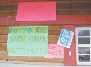"""GOODS ADVERTISED FOR SALE — A former drive-in restaurant at Mayking which now calls itself TFX is among the targets of a new ordinance making its way through the Letcher Fiscal Court. The new law would make it illegal to sell synthetic marijuana and other herbal drugs sold as """"potpourri"""" and """"bath salt."""" (Eagle photo)"""