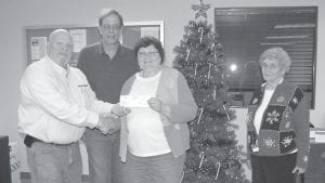 Ferus Inc. base manager Fred Adams (left) presented a $5,000 check to the Letcher County Food Pantry on Dec. 15. Also pictured are Roger McDonald, Geraldine McDonald and Waughletia Little. Adams said this marks the second year the liquid nitrogen plant in Jenkins has contributed to the food pantry during the holiday season.
