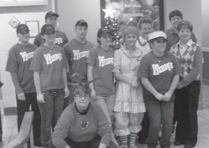 Wendy's of Whitesburg recently held its annual Christmas for Foster Kids. Pictured are (kneeling) Rebecca Mullins, (first row, left to right) Michelle Owsley, Ashley Sexton, Cody Collins, Tiffany Hatton, 'Wendy', Tabitha Craft, Manager Diane Mullins, (second row) Kasi Sturgill, Vice President of Operations Albert Dollarhide, and General Manager Scott Helle.
