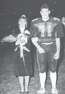 1983-84 homecoming queen Monick Wampler and her escort Paul Brooks.