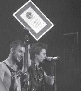 Jared Leto (right) held up honor from Guinness Book of World Records while brother Shannon Leto looked on. Both are members of the Los Angeles hard rock band 30 Seconds to Mars.