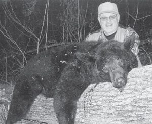 — Jerry Ingram of Smoot Creek, killed this 205-pound black bear on Linefork during the annual bear season in Letcher County. This was one of the first bears killed in Letcher County since the season started three years ago. It was Ingram's first year hunting bears, and he said he felt very lucky to get one. He plans to have the bear mounted for a trophy and there is bear meat in several freezers.