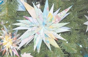 Mrs. Waddles folded this origami paper starburst with a map. Several pieces of origami made by her are on display at the Harry M. Caudill Memorial Library in Whitesburg. The starburst is Waddles' own design.