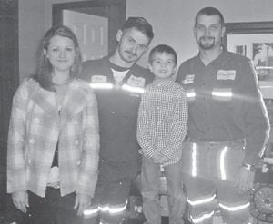 Friends and co-workers of the late Johnathan Sexton from Jarissa Coal came together and raised money to provide his son, Jayden, 5, with a wonderful and special Christmas. Pictured are Eric Frazier and his wife of Cowan, Jayden Sexton, and Jason Adams, Craft's Colly.