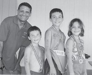 Andrew, Jonathan and Abby Little recently participated in their first triathlon in Lexington. Jonathan and Abby swam 100 meters, biked 3 miles and ran 1.5 miles. Andrew swam one length of the pool, biked 1.5 miles and ran .5 mile. They all considered running to be the hardest. Their parents Tony and Tanya Little of Cowan, sister Anna, grandparents, uncle Phillip, aunt Beth and cousin Maggie all made the trip to cheer them on. They are pictured with Sam Dick from WKYT, who helped organize the event.