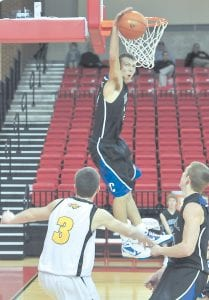Letcher Central's Kendall Ballou went high to block a shot during last week's Alpha Classic Holiday Tournament in Wise, Va. (Photo by Richard Meade)
