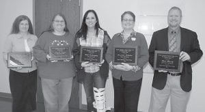 Five Hazard Community and Technical College employees received New Horizon awards, given for excellence in their jobs. From left to right are Lesa Bryant of Jackson, Student Services assistant; Angie Fugate of Hindman, Human Resources assistant; Beth Pennington of Whitesburg, Career College and Life Planning director; Deronda Mobelini of Hazard, University Center of the Mountains director; and Bart Massey of Hazard, Information Technology manager. HCTC President Dr. Steve Greiner presented the awards at a college-wide assembly.