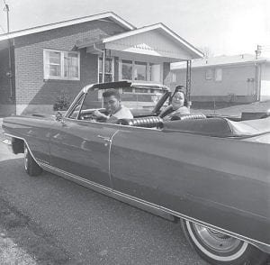 In this April 4, 1963 file photo, heavyweight boxer Cassius Clay is seen with his mother, Odessa Grady Clay, in a car outside their home in Louisville. (AP Photo/H.B. Littell)