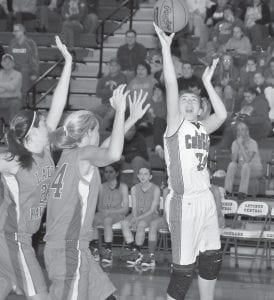 Letcher County Central High School's Kelah Eldridge drove to the basket during the Lady Cougars' 69-29 win over Pike County Central on Monday. Eldridge finished the game with 21 points in just 20 minutes of play. She scored 19 points in the first half of the game. (Photo by Chris Anderson)