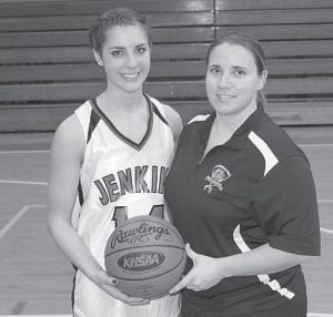 Jenkins High School basketball star Kayla Stambaugh, left, scored her 1,500th point Saturday against Buckhorn. As of Jan. 14, Stambaugh had 1507 points, 594 rebounds, 297 steals, and 166 assists for her career with the Lady Cavaliers.