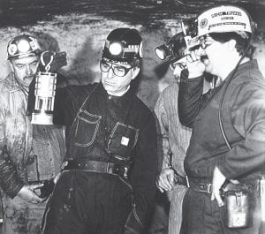 Then-UMWA President Rich Trumka (left) gave former Democratic presidential candidate Michael Dukakis (holding lantern) a tour of a mine in Cedar Grove, W.Va., on May 5, 1988. (AP Photo)