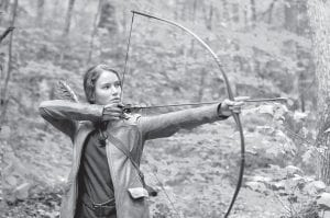 """Jennifer Lawrence portrays Katniss Everdeen in a scene from """"The Hunger Games,"""" set for release on March 23. Lawrence is among several teens fighting to the death in a televised competition in post-apocalyptic North America. (AP Photo/Lionsgate)"""
