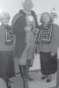 """— The Rev. Mark Collins, son of Eddie Collins and the late Sue Collins, formerly of Whitesburg, has portrayed George Washington in the miniseries """"The Revolution"""", shown on the History Channel; in the film """"National Treasurer""""; on stage; and in speaking engagements. Collins, of Yorktown, Tex., is the same height and has the same color hair and same build as Washington. He is pictured with his cousins Sally Caudill (left) and Rebecca Ann Reynolds, members of the Pine Mountain Chapter of the Daughters of the American Revolution."""