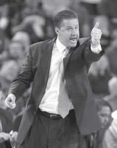 Kentucky coach John Calipari directed his team in the first half against Georgia on Tuesday. The Wildcats won. (AP)