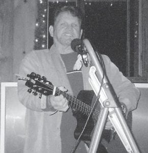 """Marlowe Tackett performed at the Howard family Christmas party at the Cowan Community Center. """"He did some pretty singing,"""" says Whitesburg correspondent Oma Hatton. """"We were so glad to have him and we are so proud for all he did for the children and the adults for Christmas and how he made a better Christmas for lots of folks. Thank you, Marlowe!"""""""