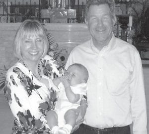Lee and Mabel Fay Bentley Carroll of Jensen Beach, Fla., are pictured with their six-month-old grandson, Will. She is the daughter of Thelma Cook Bentley and attended Whitesburg High School.