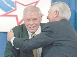 Country music great Tom T. Hall, left, got a hug from Kentucky Gov. Steve Beasher in the Capitol rotunda in Frankfort after the two appeared together at a news conference promoting a Country Music Road to Fame talent contest. The contest is open to to residents of Letcher and 14 other eastern Kentucky counties that border U.S. Highway 23. Related story appears inside. (AP Photo/John Flavell)