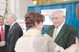 Country Music great Tom T. Hall, right, greeted a well-wisher after promoting the Country Music Highway Road to Fame talent contest Tuesday in the Capitol rotunda in Frankfort. At left is Gov. Steve Beshear. (AP/Photo John Flavell)