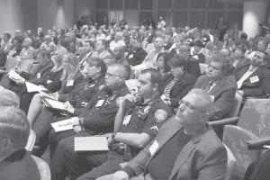 Attendees, including law enforcement officers from various agencies, listen to a speaker at the Kentucky Prescription Drug Abuse summit held at the University of Kentucky Albert B. Chandler Hospital in Lexington last week. (AP Photo/Lexington Herald-Leader, Charles Bertram)