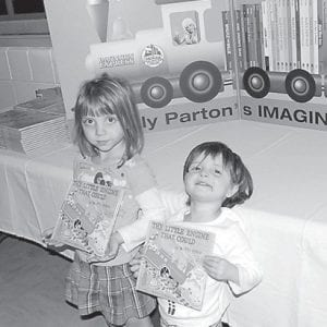 — The first children to register for Dolly Parton's Imagination Library were sisters Victoria and Goldie Kalahan on Jan. 26 at the Letcher County Recreational Center in Whitesburg. Children under the age of five who register and who have a 911 address and mailing address in the Whitesburg 41858 area will receive a book each month until they reach their fifth birthday. The program is sponsored by the Whitesburg Rotary Club.