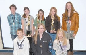 Eight contestants competed in the Letcher County Public Schools spelling bee Feb. 10. Pictured (front row, from left) are Kalin Branham, a fifth-grade student at Fleming-Neon Elementary School; Laura Stiltner, a seventh-grade student at Letcher Elementary; Katelyn Ison, a fifth-grade student at West Whitesburg Elementary; (back row) Judson Collins, an eighth-grade student at Cowan Elementary; Brooke Saurer, a sixth-grade student at Whitesburg Middle School; Kirsten Sexton, a seventh-grade student at Arlie Boggs Elementary; Erica Gibson, a seventh-grade student at Martha Jane Potter Elementary, and Brandi Pease, an eighth-grade student at Beckham Bates Elementary. Saurer won the spelling bee. Sexton placed second and Gibson placed third.