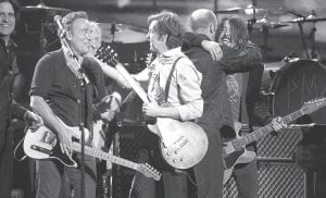 From left, Rusty Anderson, Bruce Springsteen, Joe Walsh, Paul McCartney and Dave Grohl performed during the Grammy Awards. (AP Photo)
