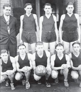 1927-28 WHS BOYS BASKETBALL TEAM — Standing left to right are Coach Marvin Glenn, Blair Adkins, Kelly Ewen, Lincoln Combs. Seated left to right are Olan Cook, Lester Day, Hillard Hall, Woodrow Whitaker and Henry Wright. Not pictured is Cecil Baker.
