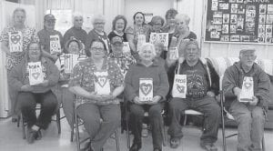 — Celebrating Valentine's Day at the Colson Senior Citizens Center were (front row, left to right) Elisha Baker, Pat Mullins, Eddie Logan, Jerry Lucas, (second row) Nora Logan, Connie Cook, Lucky Sexton, Bonnie Craft, (third row) Debbie Isaac, Brenda Seals, Opaline Anderson, Joann Hall, Opal Fouts, Beth Mason, Henrietta Thomas, Linda Sturgill and Imogene Sexton.
