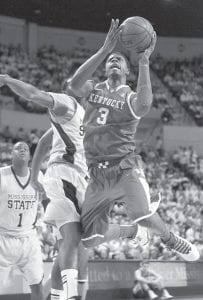 Kentucky forward Terrence Jones (3) got a shot past Mississippi State center Wendell Lewis (30) in the first half of a game UK came back to win in Starkville, Miss., on Tuesday night. (AP Photo/Rogelio V. Solis)