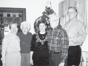 FAMILY PORTRAIT — Mary Emma and Maurice Lewis are pictured with their, Anne, Martin and Sue.