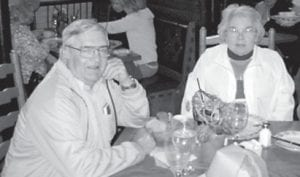 Buddy and Donna Roe enjoy a meal on one of their vacation trips to the Carolinas.