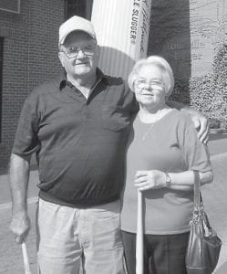 Buddy and Donna Roe visit the Louisville Slugger factory.