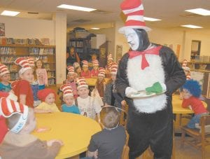 """The Cat in the Hat, played by Adams, recited Dr. Seuss's book, """"Green Eggs and Ham"""" to the kindergarten class at West Whitesburg Elementary School. Adams was in high demand among schools in the county last week as schools wanted Adams to be a part of each school's celebration of Read Across America week and Dr. Seuss's birthday."""