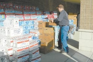 Mountain Comprehensive Health Corporation CEO Mike Caudill unloaded water while volunteering in West Liberty.