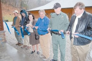 — Pictured cutting ribbon for the Letcher County Extension Outdoor Education Center on March 2 (from left) are Dave Owsley, contractor of the Letcher County Extension Outdoor Education Center; Donald Carter, of 84 Lumber; Frances Whitaker, a new member of the Board of Directors of the Letcher County Cooperative Extension Taxing District; Mitch Whitaker, a master falconer; Frank Campbell, regional supervisor with the Kentucky Department of Fish and Wildlife; and Letcher County Judge/Executive Jim Ward.