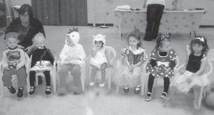 — Librarian Jenay Hall read stories, sang songs and made a scary spider during story hour at the Harry M. Caudill Memorial Library in Whitesburg. Eight children attended the Halloween party and dress up day. From left to right are Brady Boggs, Evany Pack, Cainan Lind, Jasmine Adams, Macey Warf, Maddi Frohnapfel, Ela Cuellar. Not pictured is Amaiya Hall.