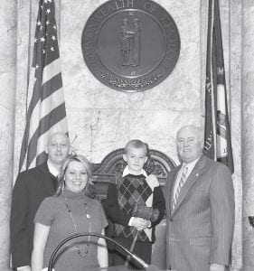 Isaiah B. McCall (above) recently served as a page for Senator Johnny Ray Turner, D-Prestonsburg, on the floor of the Kentucky State Senate. Isaiah is the son of Bennie and Allison McCall of Jenkins, who are also pictured, and is a fourth grader at Fleming- Neon Elementary School.