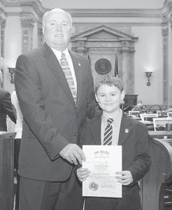 Zachary Clay Hall (right) was honored on the floor of the Senate after serving as Sen. Turner's page for the third year. Zach, 7, is a second grader at West Whitesburg Elementary. He is the son of Charles and Brandee Hall. Zach's nana, Eleanor Caudill, took him to Frankfort to page.
